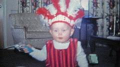 1968: Halloween kid raiders native american headdress costume Stock Footage