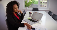 Young businesswoman having a video call on a mobile phone. Shot on RED Epic. Stock Footage