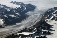 Aerial view of a glacier front and mountains in Greenland - stock photo