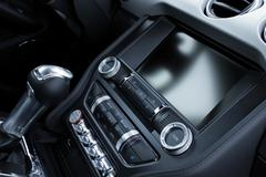 Electronic controls and gear shift knob in sport car interior detailed Stock Photos