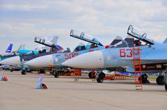 MOSCOW, RUSSIA - AUG 2015: Sukhoi fighter aircrafts presented at Stock Photos