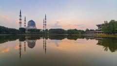 Timelapse of Beautiful Sunrise overlooking the Shah Alam Mosque with reflection Stock Footage