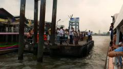 View from express boat make fast to Tha Tien floating pier, people crowd Stock Footage