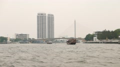 Flat perspective Chao Phraya river view, two bridges and tall condo tower Stock Footage