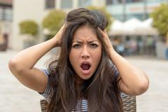 Young woman with a frantic expression - stock photo