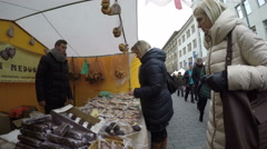 People buy sweets and nuts at candy store tent Stock Footage