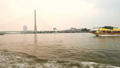 Rama VIII bridge and Chao Phraya river bank from running express boat Stock Footage