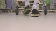 shopping cart-2, man passing with shopping cart - stock footage