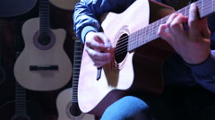 Musician playing on acoustic guitar. - stock footage