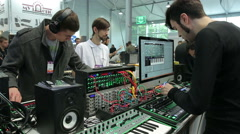 Young people tested DJ mixers in the music salon. - stock footage