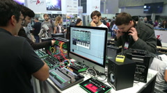Young people tested DJ mixers in the music salon. Stock Footage