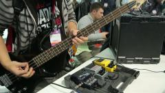 A visitor musical salon testing a new bass guitar. Stock Footage