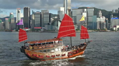 Chinese Junkboat sailing across Victoria Harbour Stock Footage