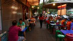 Long POV walk along and through lively asian street sidewalk in dusk Stock Footage