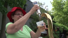 Lady pouring beer in beer garden Stock Footage