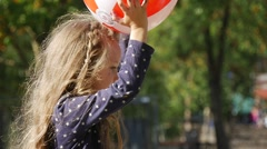Little Girl With Long Fair Hairs is Playing Ball Throws the Ball Catches the - stock footage