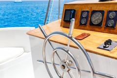 Sailing yacht control wheel and navigation implement. Stock Photos