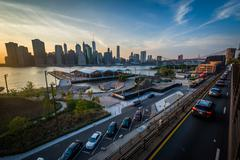 View of the Manhattan skyline at sunset, from Brooklyn Heights in Brooklyn, N - stock photo