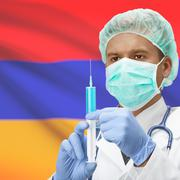Doctor with syringe in hands and flag on background series - Armenia Stock Photos