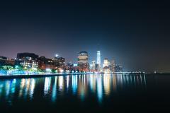 View of Lower Manhattan from Pier 34 at night, in Hudson River Park, Manhatta - stock photo