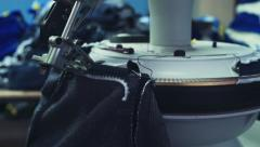 Professional sewing equipment in process on garment factory Stock Footage