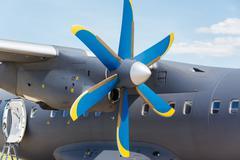 Blue propeller passenger plane close up - stock photo