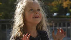 Little Girl With Long Fair Hairs is Raising Her Hands Playing Ball Throws the - stock footage