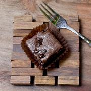 Pieces of chocolate brownie on a wooden with fork Stock Photos