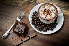 Cup of latte coffee with brownie cake - stock photo