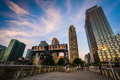 Pier and Long Island City at sunset, seen from Gantry Plaza State Park, Queen Stock Photos