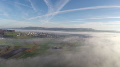 Aerial flight over a sea of fog near Sursee in Switzerland Stock Footage
