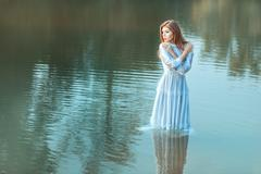 In the middle lake there is a girl. - stock photo