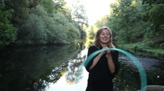 Hula hoop girl is performing on a beautifil lake Stock Footage