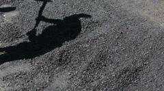 Worker lying hot asphalt Stock Footage