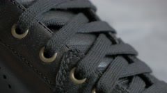Leather black sneaker close-up details 4K 2160p UltraHD footage - Leather mod Stock Footage