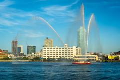 Fire boat spraying water over the East River, seen from Roosevelt Island, in  Stock Photos