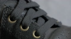 Black leather sneaker close-up details 4K 2160p UltraHD footage - Leather mod Stock Footage