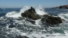 Water crushes in the cliffs Stock Footage