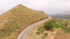 Flying over a rural road in the mountains of Madeira, Portugal Stock Footage