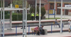 People Sit On The Benches And Stand On Platform Main Railroad Station People - stock footage