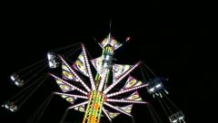Fair Attraction - Flying Chain Wheel Ride - Night Time - 01 Stock Footage
