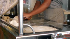 Woman Pinning out and Rolling Dough in Kitchen Stock Footage