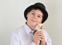 Boy teenager with a mousetrap in hands of - stock photo