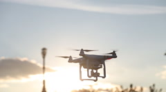 A personal drone flying through the air - stock footage