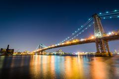 The Williamsburg Bridge at night, seen from East River Park, in Manhattan, Ne - stock photo