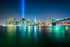 The Tribute in Light over the Manhattan Skyline at night, seen from Brooklyn  - stock photo