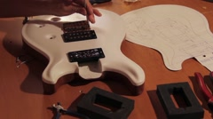 Electric Guitar Bridge Installation 2 Stock Footage