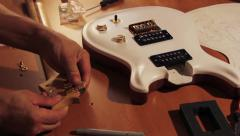 Electric Guitar Tuners Installation 1 Stock Footage