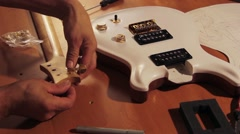 Electric Guitar Tuners Installation 2 Stock Footage