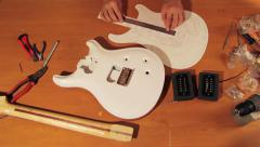Verification of Electric Guitar. Top View Stock Footage
